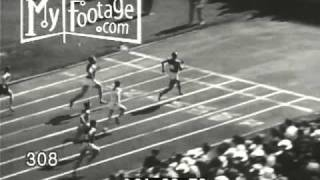 Stock Footage - SPORTS. JESSE OWENS HURDLE. BROAD JUMP. COLLEGIATE CHAMPIONSHIPS 1936