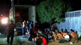 55 migrants found in back of truck
