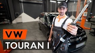 Kuinka vaihtaa etu joustintuet VW TOURAN 1 -merkkiseen autoon [OHJEVIDEO AUTODOC]