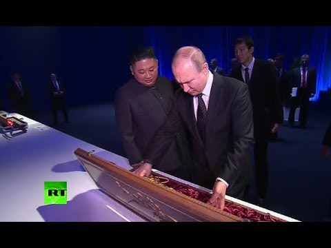 Sword exchange: Putin, Kim give each other gifts at Vladivostok summit