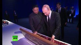 Sword exchange: Putin, Kim give each other gifts at Vladivostok summit