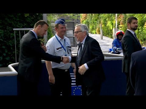 Juncker kisses policeman as he returns to the European Council Summit