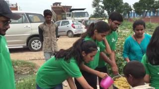 Robin Hood  Army provide free food for  poor families in the slum areas in noida