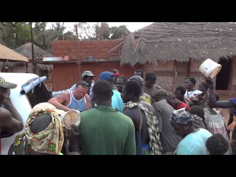 Giving food to the local people of Bubaque Island, Guinea Bissau, West Africa
