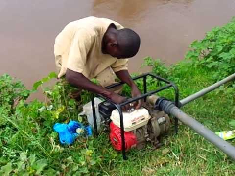 Water pump technician fixing pump ready fo irrigation/ A Thousand