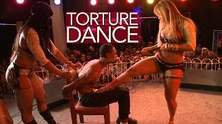 Sharp heels and hot wax: it's 'The Torture Dance'.