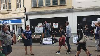 Loud Christians Preach Loudly Next To Muslim Anti-Terrorism Stall