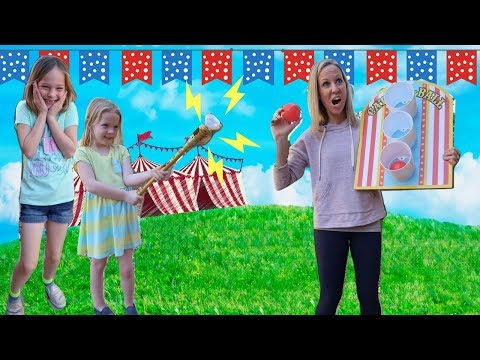 Kids Use a Magic Wand at the Super Cool Carnival