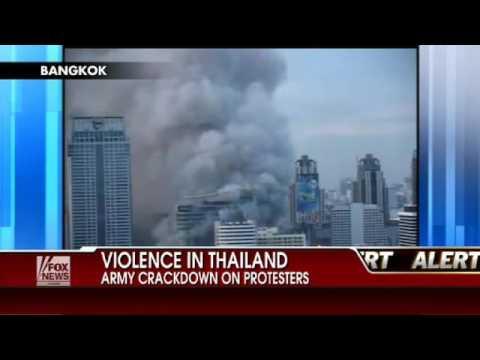 Bangkok Burns After Protest Leaders Surrender