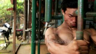 Men work out in India - Imphal Royal Gym