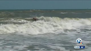 Surfers taking advantage of swells from Hurricane Maria