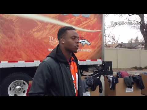 Broncos LB Brandon Marshall at a coat drive at McDonalds. Rose Andom Center and Bailey