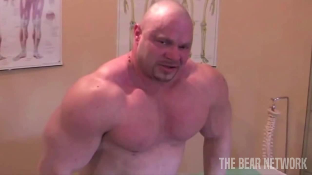 masseur works on straight bear