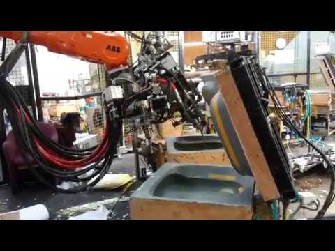ABB Robot pouring 3 urethane Foam machines into custom mouldings