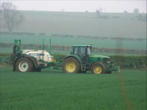 John Deere 6920s spraying with Househam trailed sprayer