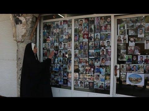 لوحة جدارية لصور ضحايا داعش بالموصل  - نشر قبل 11 ساعة