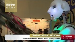 International robot exhibit wows young visitors in Russia