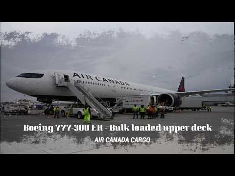Freighter Aircraft By Air Canada - Boeing 777 ER - Offloading Upper Deck Medical Supplies.