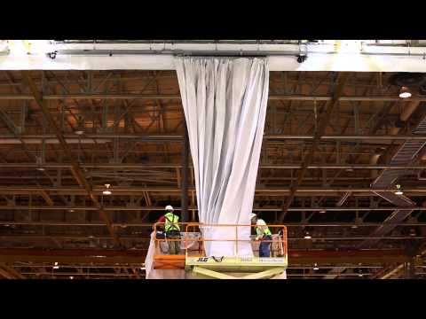 Motorized industrial room dividing curtain. Michoud Assembly Facilities