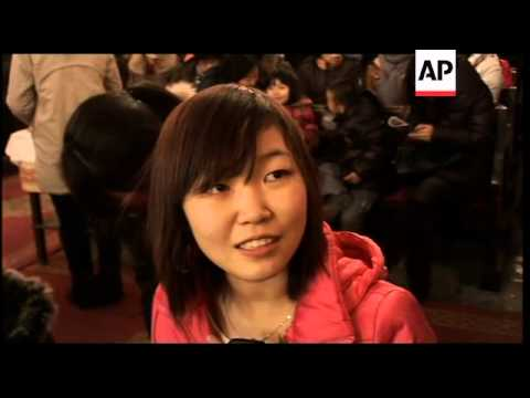 Hundreds cram into Beijing cathedral for midnight mass