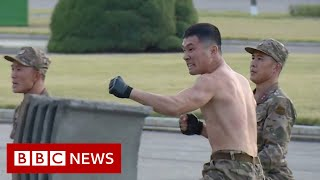 North Korea soldiers smash bricks in combat display - BBC News