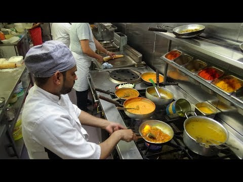 The Heat Of The Curry Master's Kitchen On A Busy Friday Night At Shambhala Village Indian Restaurant