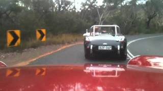 Austin Healey Sprites Tearing Down Some Windy Roads