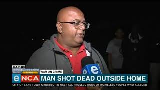 Man shot dead outside his home