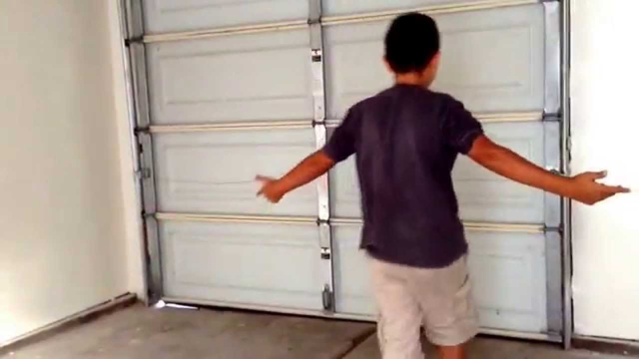 How to walk through a garage door with style. - YouTube