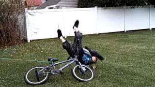 kid on bike tied to tree