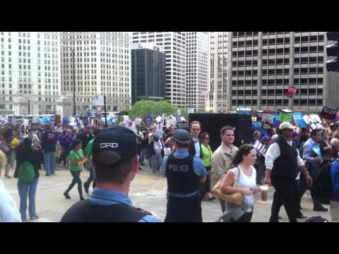 IL Citizens march to protest education, healthcare, wage cuts to pay for tax cuts to the wealthy.