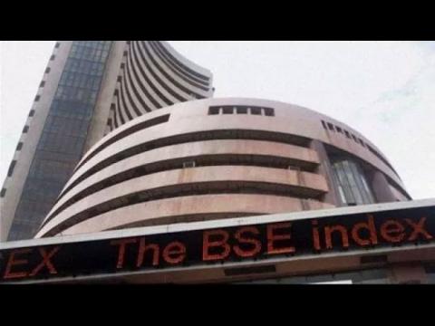 Sensex slips 25 points, Rupee falls 13 paise against dollar