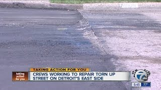 Crews working to repair torn up street on Detroit