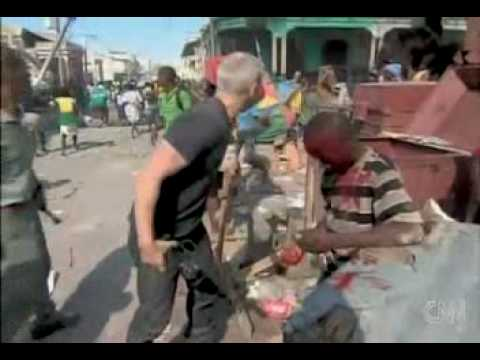 RAW_ ANDERSON COOPER RESCUES INJURED BOY FROM HAITI EARTHQUAKE RIOT (CNN FOOTAGE).mpg