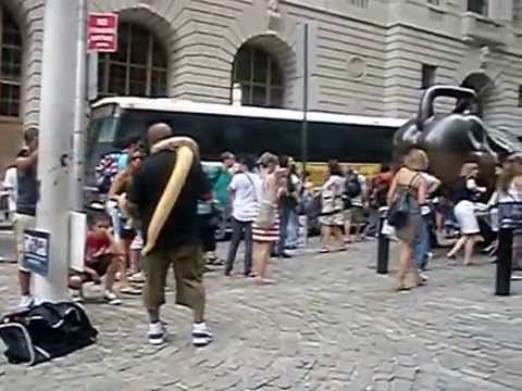 Entertainers and tourists by The Charging Bull in Downtown NYC