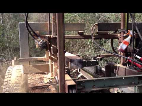 Hydraulic Band Saw Mill cutting antique reclaimed heart pine beams