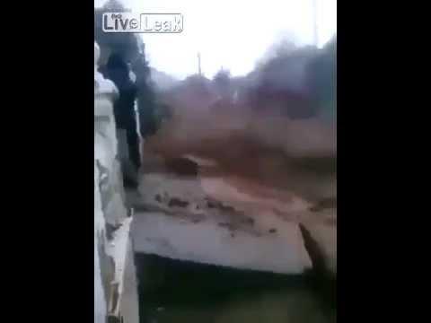 Brazilian Dam Bursts: River of Mud Powers Through Village.