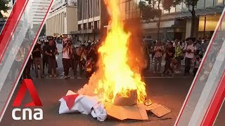 Hong Kong protesters build barricades and start fires after mask ban