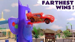 Disney Cars Toys McQueen in the PJ Masks farthest wins race with Hot Wheels Superhero Cars TT4U