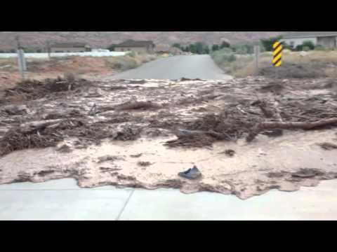 Flash Flood Washes Across Utah Desert Road