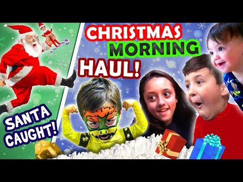 SANTA CAUGHT on CHRISTMAS w  ELF!  FUNnel Family X Mas HAUL 2016 Presents + North Pole Snow Vlog