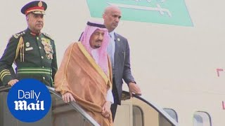 Saudi Arabia's King Salman descends from plane on GOLD escalator - Daily Mail