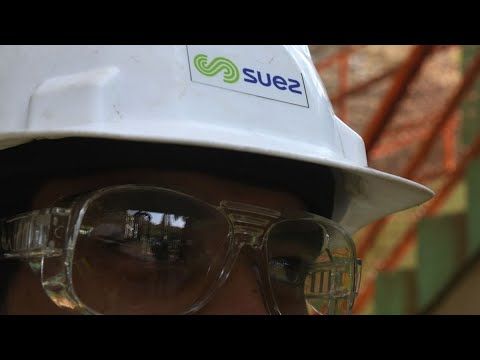 Suez Says Businesses Won't Return to Normal For a Year