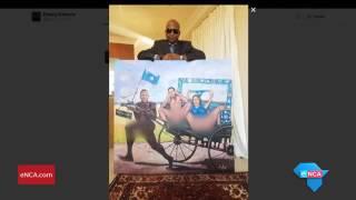 Kunene posses with new DA painting