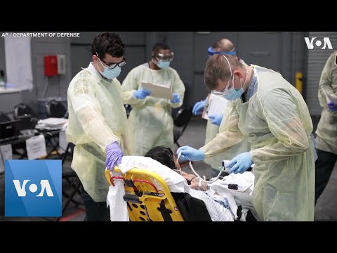 US Military Treats Virus Center at Field Hospital in New York City Convention Center