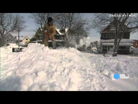 Heavy snow buries cars as New York gets pounded again