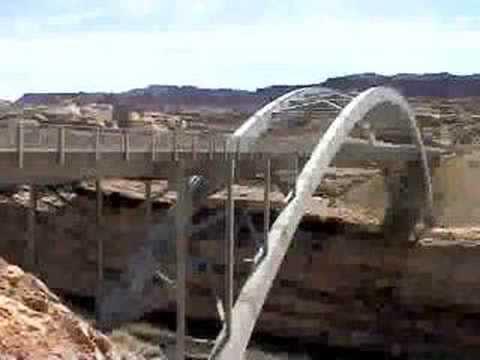 Airplane flies under Utah bridge