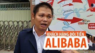 Lái Innova giăng băng rôn đòi công ty Alibaba trả lại tiền ở Sài Gòn