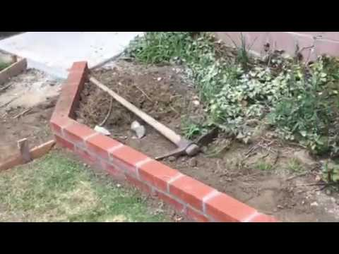 Installation Of A Brick Planter In Back Yard By Crown Construction