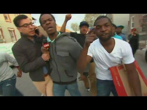 Baltimore protesters swarm CNN live report